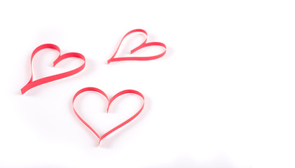 three red heart shape on white background