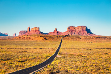 Wall Mural - Highway in Monument Valley at sunset, USA
