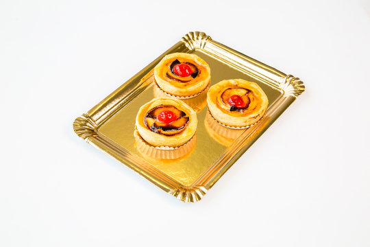 small fruit cakes on a white background