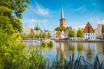 Wall Mural - Historic city of Luebeck with Trave river in summer, Schleswig-Holstein, Germany