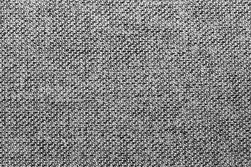 Gray and black mixed fabric texture or background, wool, tweed, melange cloth, closeup