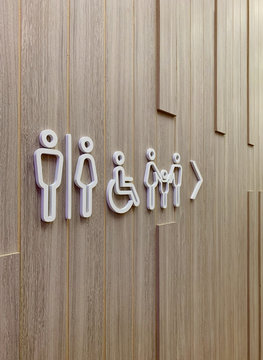 toilet sign post information on wooden wall
