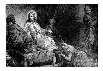 A woman wipes Jesus ' feet.