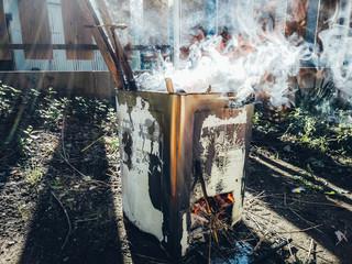 Make a fire at yard.