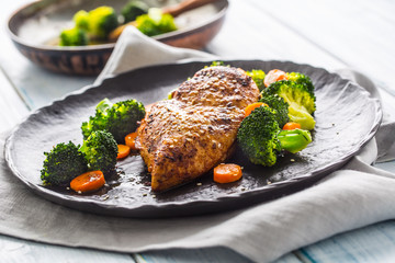 Roasted chicken breast with broccoli carrot and sesame