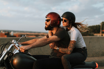 Biker couple riding down the road in the sunset Wall mural