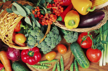 Vegetables on a white background. Cabbage, cauliflower, cucumbers, tomatoes, peppers, corn, peas, onions, carrots