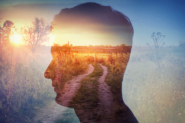 Man silhouette on rural landscape background. Psychiatry and psychology concept.