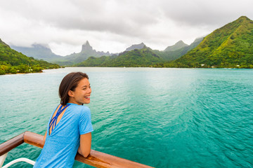 Wall Mural - Tahiti cruise ship travel vacation woman on balcony of yacht traveling on exotic oceania adventure.