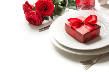 Valentine's day or birthday dinner. Elegance table setting with champagne and red rose.