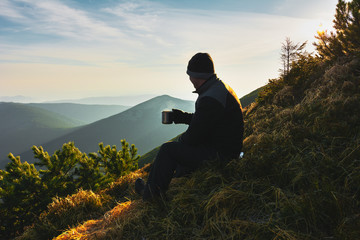 Motivating image of a man in the mountains.