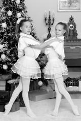 Festive little girls hugging.