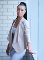 modern business woman standing near the window in the corridor