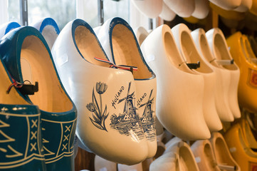 Colorful vintage Dutch wooden clogs in a shop.