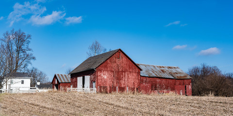 Red barn country web banner with blue sky