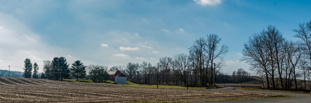 Rural countryside harvested corn field and barn banner