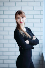 young business woman standing in the corridor of the office.