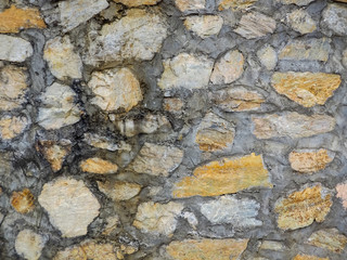 Seamless texture brown stone wall. Seamless background.
