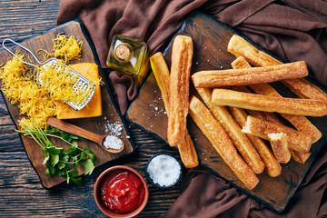 Cheese Straws, Cheesy BreadSticks on a  board