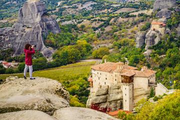 Woman take photo from Meteora monastery