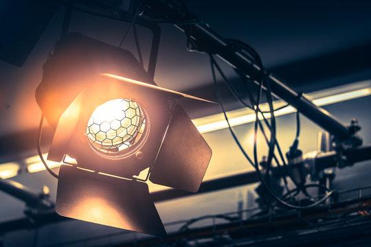 Professional orange studio spotlight in a TV studio.