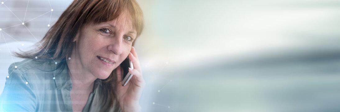 Mature woman calling on mobile phone. panoramic banner
