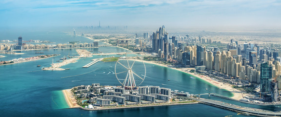 Photo sur Plexiglas Dubai Panoramic aerial view of Dubai Marina skyline with Dubai Eye ferris wheel, United Arab Emirates