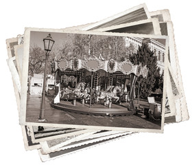 Old fashioned french carousel with horses Stack of old photos