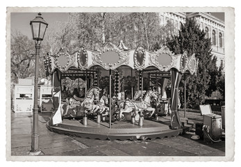 Old fashioned french carousel with horses Vintage Monochrome photo