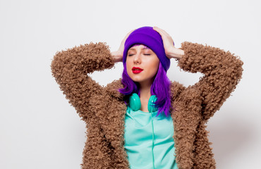 Beautiful young girl with purple hair in jacket on white background.