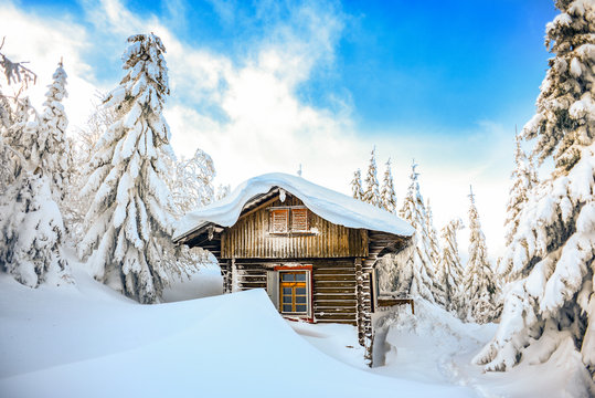 Chateau in the winter mountains, a hut in the snow. Winter mountain landscape. Karkonosze, Poland.
