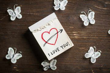"""tear-off calendar with message """"I love you"""" on top"""