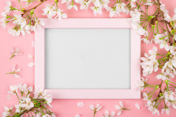 Pink springtime frame with blank space and cherry blossom