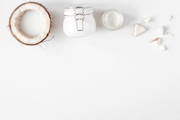 organic cosmetics with coconut on white background top view mockup