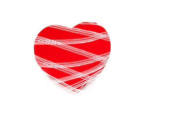 Valentines Day background with single red heart.