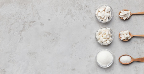 Collection of different kinds of sugar on gray background Wall mural