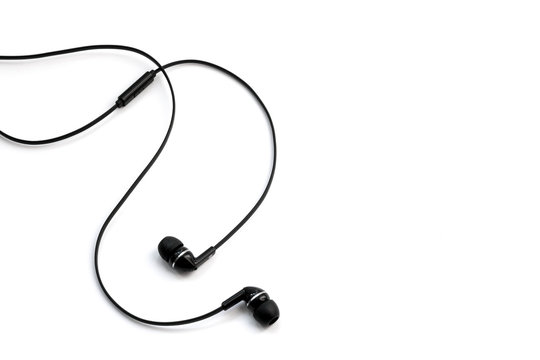 Earphones headset. In-ear headphones. Vacuum wired black headphones for listening to music and sound on portable devices: music player, smartphone, laptop on a white background. Ear plugs.