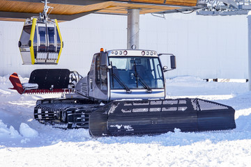 Snow plow for snowboarding and downhill skiing. cable car cabin. Snowplow. The peaks of Elbrus. North Caucasus. Russia.