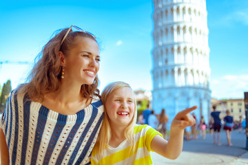 mother and child near leaning tower pointing at something
