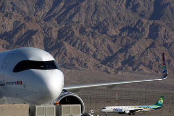 An Arkia Israeli Airlines Embraer ERJ-195AR plane is seen in the background at Ramon International Airport after an inauguration ceremony for the new airport, just outside the southern Red Sea resort city of Eilat, Israel