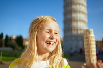 happy modern girl looking at leaning tower of Pisa souvenir