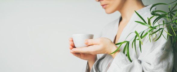 A beautiful woman holding teacup. Asian food theme background with tea ceremony. Brewing and Drinking tea. Long, wide banner.