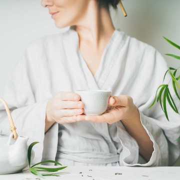 A beautiful woman holding teacup. Asian food theme background with tea ceremony. Brewing and Drinking tea.