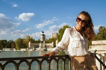 happy trendy traveller woman in Madrid, Spain