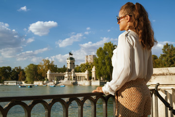 traveller woman at Buen Retiro Park looking into distance