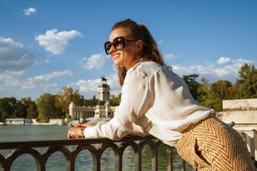 woman at El Retiro Park in Madrid, Spain looking into distance