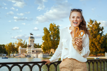 woman at Buen Retiro Park with traditional Spain churro