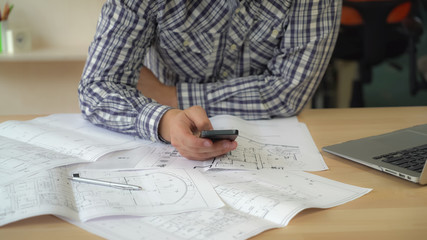 Close up worker in creative agency holding smartphone