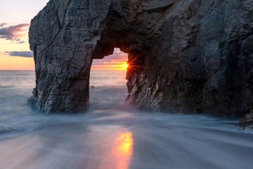French landscape - Bretagne. A beautiful beach with wild cliffs in the background at sunset.