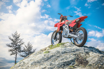 Red motorcycle on top of mountain landscape. 3d